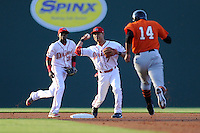 Outfielder Rafael Rodriguez (14) of the Augusta GreenJackets is easily out at second as second baseman Mookie Betts (7) of the Greenville Drive turns the double play on Thursday, May 9, 2013, at Fluor Field at the West End in Greenville, South Carolina. Backing up the play at left is shortstop Jose Vinicio (36). Augusta won, 6-3. (Tom Priddy/Four Seam Images)