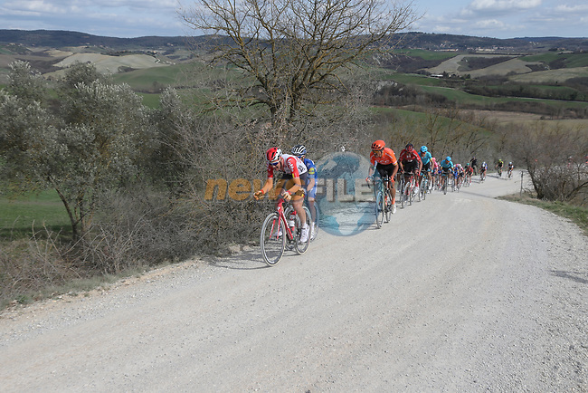 The peloton including Tim Wellens (BEL) Lotto-Soudal, Julian Alaphilippe (FRA) Deceuninck-Quick Step and Greg Van Avermaet (BEL) CCC Team give chase on sector 8 Monte Santa Maria during Strade Bianche 2019 running 184km from Siena to Siena, held over the white gravel roads of Tuscany, Italy. 9th March 2019.<br /> Picture: Eoin Clarke | Cyclefile<br /> <br /> <br /> All photos usage must carry mandatory copyright credit (© Cyclefile | Eoin Clarke)