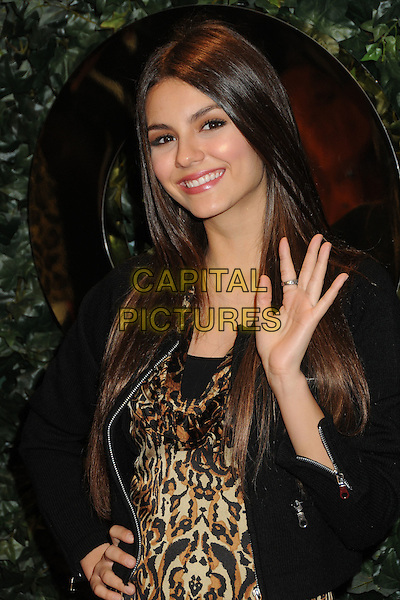 VICTORIA JUSTICE.QVC Red Carpet Style Party held at the Four Seasons Hotel, Beverly Hills, California, USA..February 25th, 2011.half length black jacket brown beige leopard print top hand waving .CAP/ADM/BP.©Byron Purvis/AdMedia/Capital Pictures.