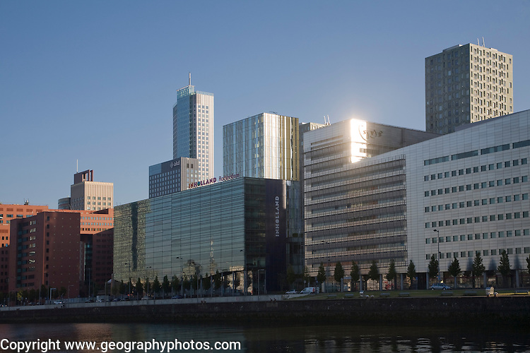 Early morning sunlight shining on modern buildings in Rotterdam, Netherlands