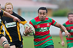 Sio Petelo makes a break past Josh Chamberlain and Caleb Brown. Counties Manukau Premier Club Rugby game between Waiuku and Bombay, played at Waiuku on Saturday July 5th 2010. Waiuku won 59 - 14 after trailing 12 - 14 at halftme.