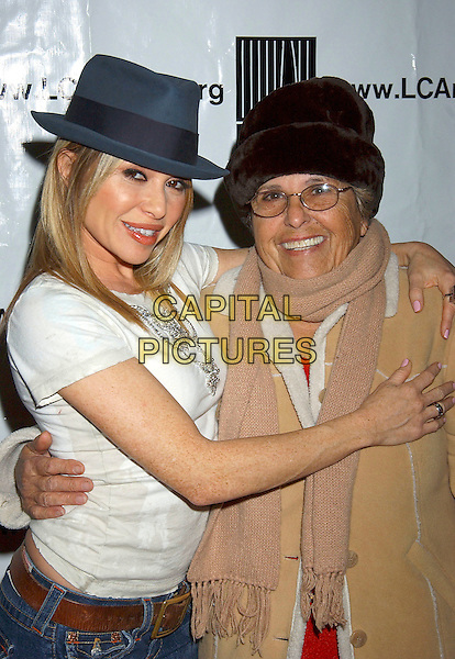 "E.G. DAILY & GUEST.World Premiere of  ""Listen Closely'""a one woman autobiographical musical about a show business saga, held at The Court Theatre, Los Angeles, California, USA, .18 February 2005..half length hat.Ref: ADM.www.capitalpictures.com.sales@capitalpictures.com.©LFarr/AdMedia/Capital Pictures ."