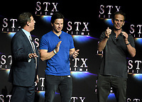 LAS VEGAS, NV - APRIL 24: (L-R) Chairman of STXfilms Adam Fogelson, actor Mark Wahlberg, and Director Peter Berg onstage during the STX Films presentation at CinemaCon 2018 at The Colosseum at Caesars Palace on April 24, 2018 in Las Vegas, Nevada. (Photo by Frank Micelotta/PictureGroup)