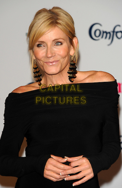Michelle Collins.Prima High Street Fashion Awards, Battersea Evolutions, Battersea Park, London, England..September 8th, 2011.half length dress black gold silver dangling earrings .CAP/CJ.©Chris Joseph/Capital Pictures.