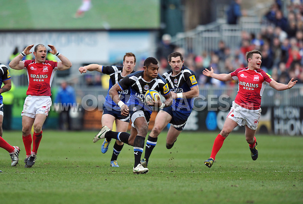 Semesa Rokoduguni runs through a gap in the London Welsh defence. Aviva Premiership match, between Bath Rugby and London Welsh on March 30, 2013 at the Recreation Ground in Bath, England. Photo by: Patrick Khachfe / Onside Images