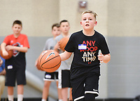 """Bryson Woodall, 11, of Gentry runs a basketball drill, Sunday, February 9, 2020 during a basketball tryout at Rogers High School in Rogers. Check out nwaonline.com/200210Daily/ for today's photo gallery.<br /> (NWA Democrat-Gazette/Charlie Kaijo)<br /> <br /> Coach Chad Neipling started a new AAU (Amateur Athletic Union) basketball team called the NWA Devils to provide young basketball players opportunities to build their fundamentals and conditioning in the sport and compete against other AAU teams at a national level. The program gives kids national recognition, tracks player stats and attracts attention from coaches.<br /> <br /> Neipling and other parents wanted additional basketball programs for their kids but found problems in other programs they tried so he started his own. """"Our kids played competitively together. We had been a part of some organizations Where we had to pay a lot of money to get our kids there. Sometimes we'd show up and we didn't have a facility or we went to a tournament and we weren't in the tournament. There wasn't a focus on the fundamentals. A lot of it we felt like was a money grab.""""<br /> <br /> After selecting the players for the team, they will prepare for their first tournament in March. He wants to provide competitive opportunities for the kids but also ensure they grow to be good people. """"We're gonna do some community service. We'll go out and go to the Arkansas food bank,"""" he explained to the kids before starting the tryout. """"I want you to go out in the community and be seen. It's about building great people before a great basketball player."""""""