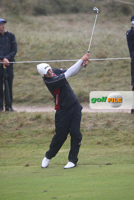 Julien Quesne (FRA) in full wet weather gear takes an iron shot to the 9th during Round Three at the KLM Dutch Open, from the Kennemer Golf & Country Club, Zandvoort, Netherlands. Picture:  David Lloyd / www.golffile.ie