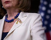 """Speaker of the United States House of Representatives Nancy Pelosi (Democrat of California) wears a pin reading, """"One country, One destiny"""" during a press conference at the United States Capitol in Washington D.C., U.S., on Thursday, December 5, 2019.  Earlier this morning, she announced the United States House of Representatives would begin drafting articles of impeachment against United States President Donald J. Trump."""