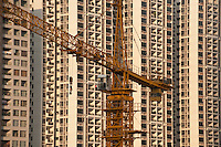 Daytime Landscape View Of A Construction Crane And Commercial Building Constructionin Guangzhou, China.  © LAN