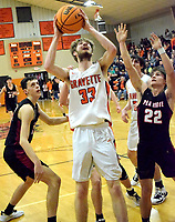 Westside Eagle Observer/MIKE ECKELS<br /> <br /> After fighting his way past three Blackhawk defenders, Brayden Trembly (33) goes for a layup during the third quarter of the Gravette-Pea Ridge conference game in the competition gym Friday night.