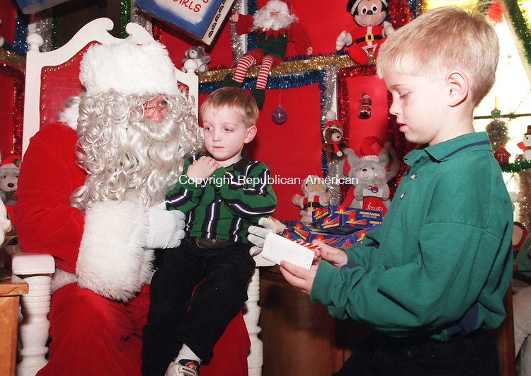 TORRINGTON, CT 12/06/98--1206DC15.tif Luke Pepper (L) and his brother Lance (R) tell Santa what they want for Christmas at the opening of The Christmas Village in Torrington 06 Dec.-DOUG COLLIER staff photo (Filed in Scans/Scan-In)
