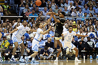 CHAPEL HILL, NC - MARCH 03: Brandon Childress #0 of Wake Forest University passes the ball over Cole Anthony #2 of the University of North Carolina during a game between Wake Forest and North Carolina at Dean E. Smith Center on March 03, 2020 in Chapel Hill, North Carolina.