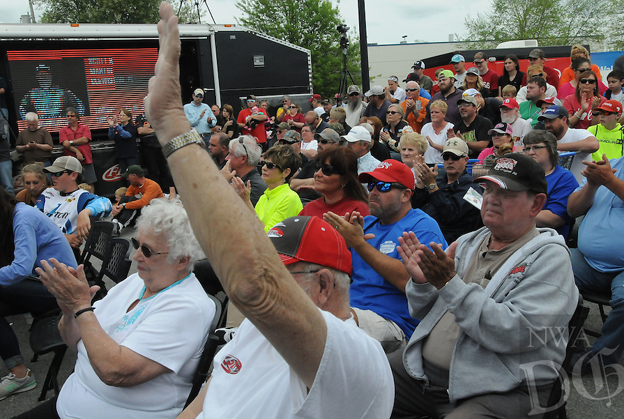 NWA Democrat-Gazette/FLIP PUTTHOFF <br /> Fishing fans including Bob Carnes of Rogers (right) applaud anglers Sunday April 17, 2016 during the final weigh-in.