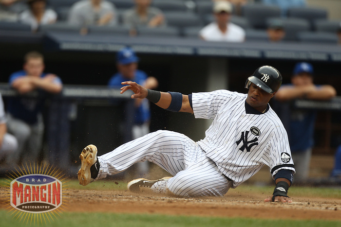 NEW YORK, NY - JULY 25:  Robinson Cano #24 of the New York Yankees slides home safely against the Kansas City Royals during the game at Yankee Stadium on July 25, 2010 at Yankee Stadium in the Bronx borough of New York City. Photo by Brad Mangin