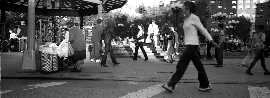 Pedestrian traffic outside of the Union Square subway station. Subway series shot in New York between the years 1998 and 2001