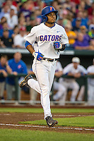 Richie Martin (12) of the Florida Gators runs during a game between the Miami Hurricanes and Florida Gators at TD Ameritrade Park on June 13, 2015 in Omaha, Nebraska. (Brace Hemmelgarn/Four Seam Images)