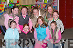 HAPPY: Happy faces in the large crowd to watch the Samhaiocht Easter Parade on Saturday night in Tralee. Front l-r: Lorraine Kelly, Laura and Emily Switzer, Riadh and Tirna Brosnan. Back l-r: Lucy Kelly, Rebecca O'Halloran, Molly Twomey and Saoirse Brosnan..