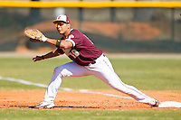 First baseman Jose Rodriguez #19 of the College of Charleston Cougars stretches for a throw against the Davidson Wildcats at Wilson Field on March 12, 2011 in Davidson, North Carolina.  The Wildcats defeated the Cougars 8-3.  Photo by Brian Westerholt / Four Seam Images