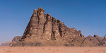 "Jabal al-Mazmar (The Mountain of Plague), was named ""The Seven Pillars of Wisdom in 1980's after book by T.E. Lawrence  the Wadi Rum Protected Area, a UNESCO World Heritage Site.  The mountain is composed of Um Sahn sandstone with a base layer of basalt.  Hashemite Kingdom of Jordan."