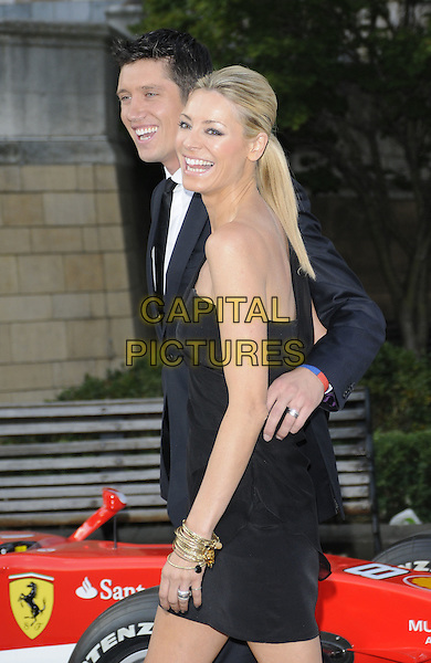 VERNON KAY & TESS DALY .The F1 Party held at the Natural History Museum, London, England, UK..5th July 2010.Formula one half 3/4 length black sheer one shoulder dress clutch bag suit tie white shirt married husband wife arm around waist side smiling laughing .CAP/CAN.©Can Nguyen/Capital Pictures.