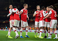 Teammates celebrate with Joe Willock of Arsenal after scoring a goal 3-0 during the UEFA Europa League match between Arsenal and Standard Liege at the Emirates Stadium, London, England on 3 October 2019. Photo by Andrew Aleks.