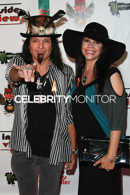 LOS ANGELES, CA, USA - OCTOBER 26: Robert Sarzo, Avery Sarzo arrive at An Evening Of Art With Billy Morrison And Joey Feldman Benefiting The Rock Against MS Foundation held at Village Studios on October 26, 2014 in Los Angeles, California. (Photo by David Acosta/Celebrity Monitor)