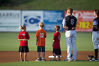 A group of young baseball players join Kannapolis Intimidators shortstop Max Dutto (6) on the field for the National Anthem prior to the game against the Delmarva Shorebirds at Kannapolis Intimidators Stadium on June 25, 2016 in Kannapolis, North Carolina.  The Intimidators defeated the Shorebirds 2-1.  (Brian Westerholt/Four Seam Images)