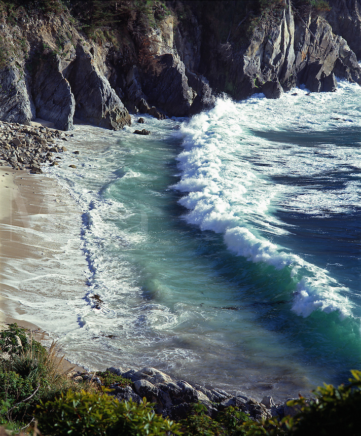 A PACIFIC WAVE meets the shore in the CARMEL HIGHLANDS - MONTEREY BAY SANCTUARY, CALIFORNIA..