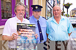 OUT OF ONE, OUT OF ALL!!! Is the slogan of The Iveragh Barwatch Scheme which was officially launched in Cahersiveen on Monday.  It's a great program said Supt. Michael O'Donovan and 'has the full support of the Gardai?'.  Pictured here l-r; Noel Kelligher(Chairman), Garda Thomas Hurley & Philip O'Sullivan.  Any Members who have not yet collected their posters they are available from Noel in the Fertha Bar.