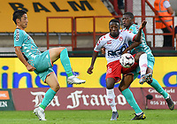 KORTRIJK , BELGIUM - AUGUST 03 : Ryota Morioka of Charleroi (left) pictured in a fight for the ball with Eric Ocansey of Kortrijk (middle) during the Jupiler Pro League match day 2 between Kv Kortrijk and Sporting Charleroi on August 03 , 2019 in Kortrijk , Belgium . ( Photo by David Catry / Isosport )
