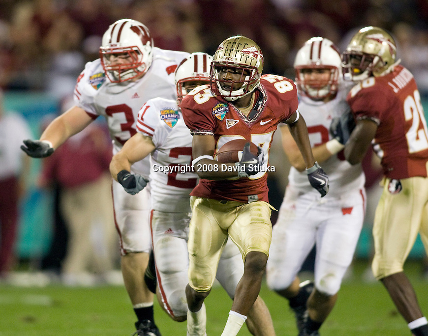 ORLANDO, FL - DECEMBER 27: Punt returner Burt Reed #83 of the Florida State Seminoles returns a punt against the Wisconsin Badgers during the Champs Sports Bowl on December 27, 2008 at the Citrus Bowl in Orlando, Florida. Florido State beat Wisconsin 42-13. (Photo by David Stluka)