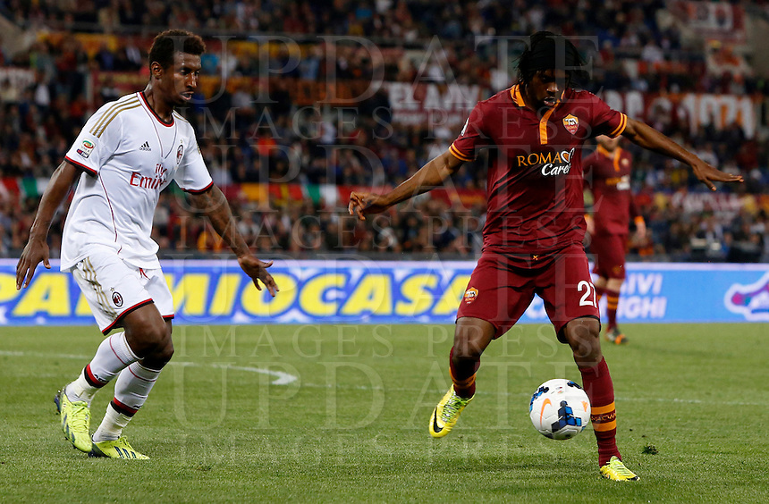 Calcio, Serie A: Roma vs Milan. Roma, stadio Olimpico, 25 aprile 2014.<br /> AS Roma forward Gervinho, of Ivory Coast, right, is challenged by AC Milan defender Kevin Constant, of Guinea, during the Italian Serie A football match between AS Roma and AC Milan at Rome's Olympic stadium, 25 April 2014.<br /> UPDATE IMAGES PRESS/Riccardo De Luca