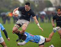 Wellington College flanker Nelson Asofa-Solomona tries to leap the tackle of Jarrod Adams during the Wellington Secondary Schools premier rugby final between Silverstream and Wellington College at Hutt Recreation Ground, Petone, Wellington, New Zealand on Sunday, 12 August 2012. Photo: Dave Lintott / lintottphoto.co.nz