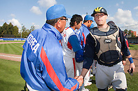 14 September 2009: Catcher Christopher Berset looks dejected after the 2009 Baseball World Cup Group F second round match game won 15-5 by South Korea over Great Britain, in the Dutch city of Amsterdan, Netherlands.