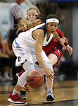 Liberty's London Pavlica and Centennial's Ajanhjai Phoumiphat fight for a loose ball during the NIAA state basketball tournament in Reno, Nev., on Friday, Feb. 23, 2018. Centennial won 74-65 in overtime. Cathleen Allison/Las Vegas Review-Journal