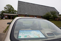 "A sign reads ""Open my goddamn church"" in the back of the car of Nancy Shilts, of Scituate, outside St. Frances Xavier Cabrini Church in Scituate, Mass., on Sun., May 29, 2016. Shilts has attended the church since it opened in 1961 and has been involved in the vigil. Members of the congregation have been holding a vigil for more than 11 years after the Archdiocese of Boston ordered the parish closed in 2004. For 4234 days, at least one member of Friends of St. Frances X. Cabrini has been at the church at all times, preventing the closure of the church. May 29, 2016, was the last service held at the church after members finally agreed to leave the building after the US Supreme Court decided not to hear their appeal to earlier an Massachusetts court ruling stating that they must leave. The last service was called a ""transitional mass"" and was the first sanctioned mass performed at the church since the vigil began."