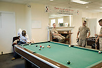 October 14, 2008. Camp LeJeune, North Carolina..  The Wounded Warrior Battalion East, at Camp LeJeune Marine Base in Jacksonville, NC. The battalion was set up to provide a place for wounded Marines to recover as they work through the issues of their injuries and wade through the paperwork involved with possible discharge or reassignment within the Marine Corps.. With little to do and at times heavily medicated, many of the Marines spend much of the days at the Battalion sleeping or playing pool..