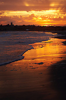 USA, Middletown, RI 2007 - A dramatic golden sunset spreads over second or Sachuest beach near Newport, RI