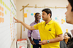 Abasi Ene-Obong is enrolled in Keck Graduate Institute's postdoctoral professional master's degree program studying bioscience management. He works with teammates Kekoaponolani Iobstm (in grey), Pancham Parikh (in yellow), and Ashi Jain (in stripes) as they go over a business process design they developed for a large pharmacy company on the campus of Keck Graduate Institute in Claremont, California, January 29, 2014.