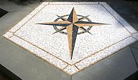Custom Compass medallion, a stone hand cut mosaic, shown in honed Giallo Reale, Nero Marquina, Calacatta Tia, Verde Luna, and Jura Green.