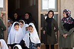 "15 June 2013, Dari Cha Noor School, Qargha, Kabul Province,  Afghanistan. School students and teachers prepare for class at the Dari Cha Noor (""Window to Knowledge"") School. The school has begun to formulate plans to improve and expand under the  Education Quality Improvement Program (EQUIP). Currently they have only organised the shura council but already they have enrolled another 75 students in the last three months. The school will benefit from the EQUIP whose objective is to increase access to quality basic education, especially for girls. School grants and teacher training programs are strengthened by support from communities and private providers.  Picture by Graham Crouch/World Bank"