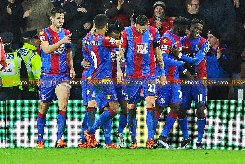 Wilfried Zaha of Crystal Palace right is congratulated after scoring the second goal to make the score 2-1 to Crystal Palace during Southampton vs Crystal Palace at St Mary's Stadium