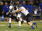 Boise State's Donte Deayon (5, rear) and Corey Bell (38) bring down Nevada receiver Hasaan Henderson (12) during the first half of an NCAA college football game in Reno, Nev., on Saturday, Oct. 4, 2014. Boise State won 51-46. (AP Photo/Cathleen Allison)