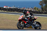 Sylvain Guintoli (FRA) riding the Aprilia RSV4 1000 Factory (50) of the Aprilia Racing Team exits turn 10 during a practise session on day two of round one of the 2013 FIM World Superbike Championship at Phillip Island, Australia. rounds turn 11 during a practise session on day two of round one of the 2013 FIM World Superbike Championship at Phillip Island, Australia.