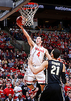 Ohio State Buckeyes guard Aaron Craft (4) rolls in a layup during the second half of the NCAA men's basketball game between the Ohio State Buckeyes and the Purdue Boilermakers at Value City Arena in Columbus, Ohio, on Saturday, Feb. 8, 2014. The Buckeyes defeated the Boilermakers, 67-49. (Columbus Dispatch/Sam Greene)