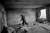 Grozny, Chechyna.1995.Russain Interior Ministry troops enter an apartment where a Chechen sniper is believe to be operating. The apartment is in the city center. They find a large bag of unspent bullets.