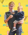 Julie Bowen & son at The 14th Anniversary of P.S. ARTS - Express Yourself 2010 held at Barker Hangar in Santa Monica, California on November 07,2010                                                                   Copyright 2010  DVS / Hollywood Press Agency