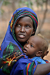 Habiba Nuno, 25, with one of her children as she pauses to rest while trekking across eastern Kenya near the Somali border. The Somali woman left her home a month earlier, fleeing drought and conflict, and heading to the Dadaab refugee complex. Already the world's world's largest refugee settlement, Dadaab has swelled in recent weeks with tens of thousands of recent arrivals from Somalia.