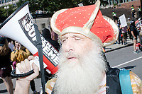 Perpetual presidential candidate Vermin Supreme uses a bullhorn to mock participants in the Straight Pride Parade in Boston, Massachusetts, on Sat., August 31, 2019. The parade was organized in reaction to LGBTQ Pride month activities by an organization called Super Happy Fun America.