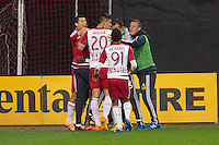 Red Bull players celebrate their first goal of the night against DC United. Red Bull NY rallied back to tie DC United 2-2 at RFK Stadium in Washington D.C. on Saturday April 11, 2015.